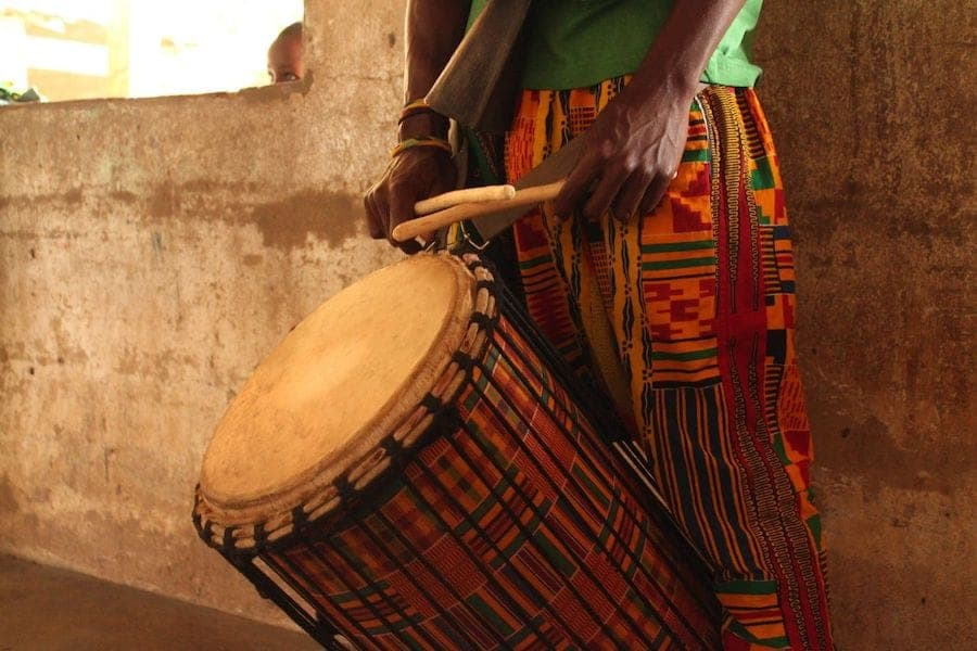Theatre in Togo. West African theatre. Yokele African bongo. Red and yellow bongo